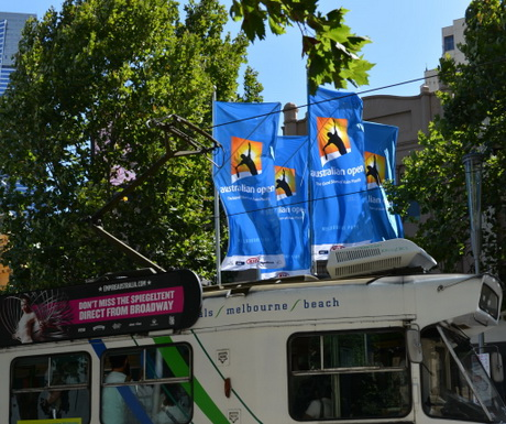 Melbourne icons, the Australian Open flags flying above a Melbourne tram